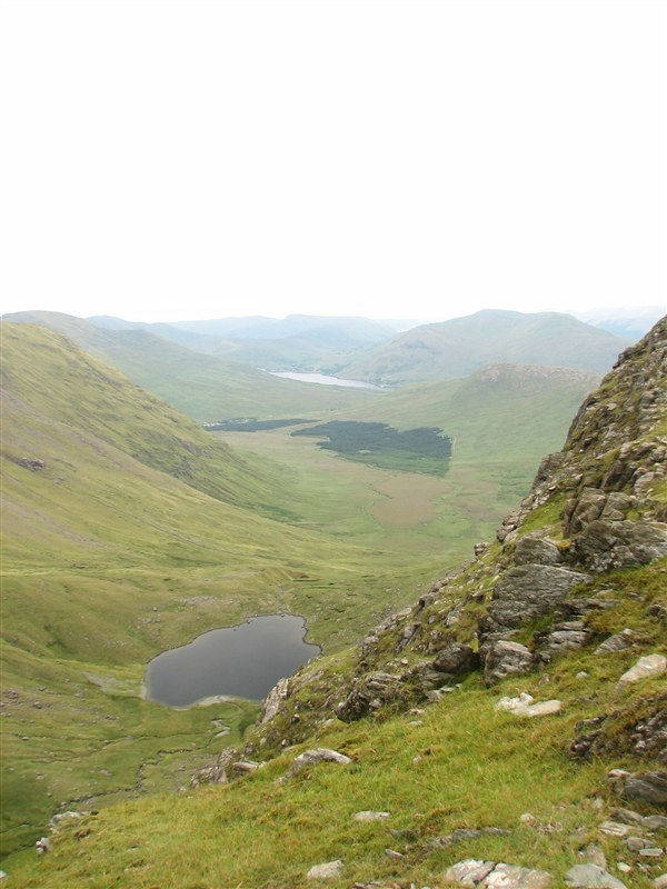 Looking down on Lough Bellawaum towards Delphi from the col on Mweelrea
